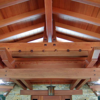 High quality redwood beams and rafters in a Craftsman style ceiling.